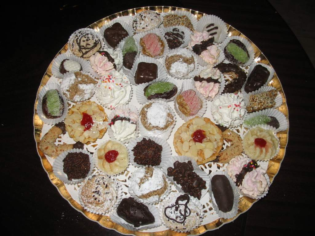 Selection of Moroccan cookies, almonds, peanuts, dates, chocolate coated, very tasty coconut